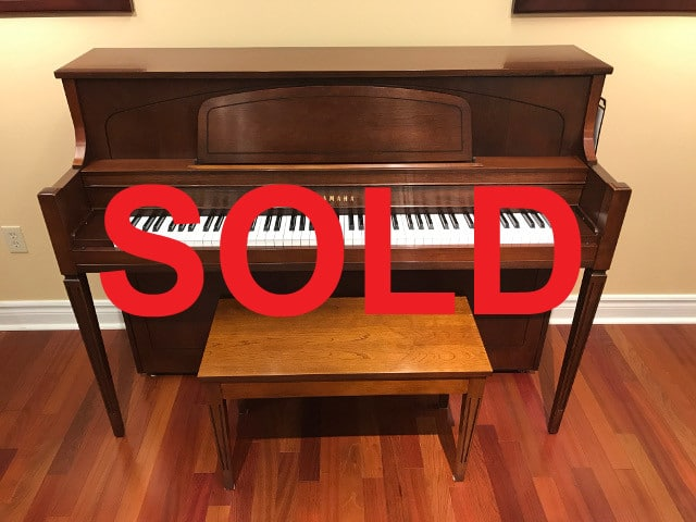1998 Model M450T Yamaha Piano and matching bench sold