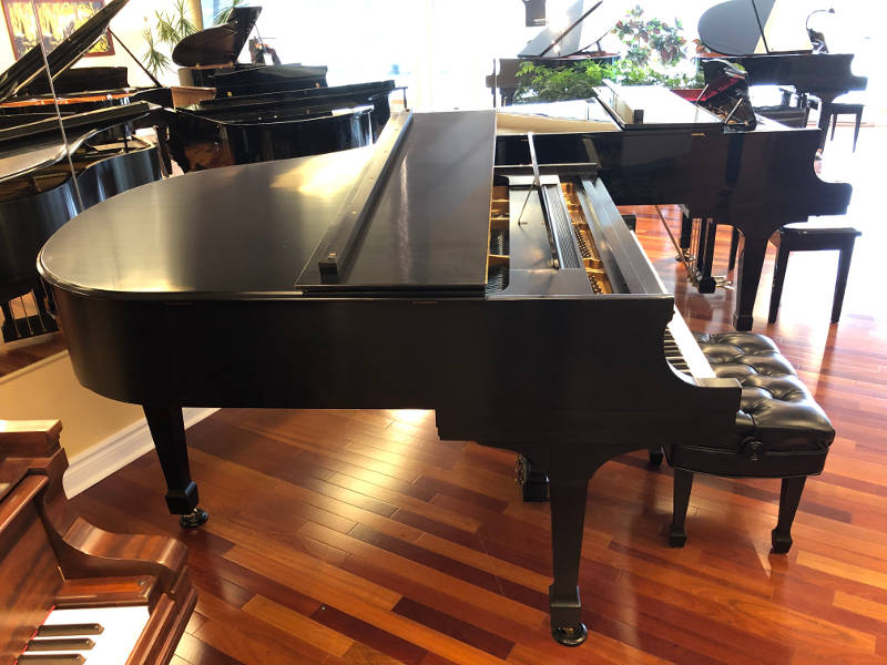 """1983, 5'7"""" model M Steinway grand piano & matching adjustable cconcert artist bench in satin ebony finish, serial #479036."""