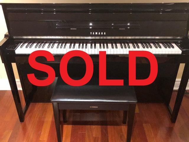 SOLD - 2014 model NU1 hybrid Yamaha piano and matching bench in polished ebony finish