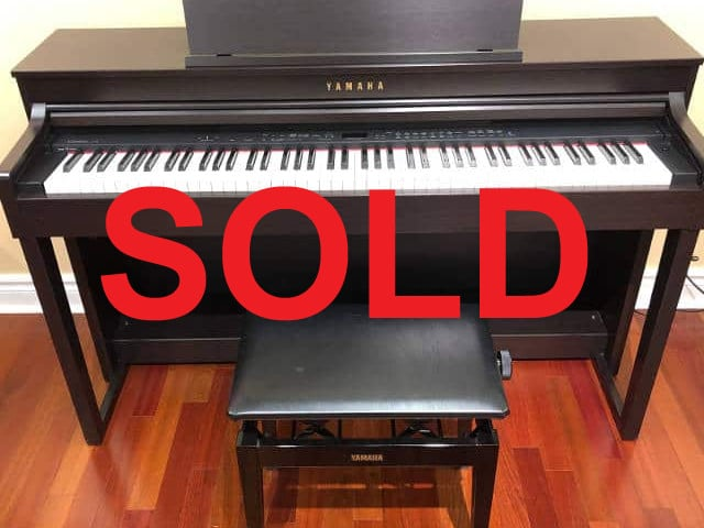 SOLD - 2011 Yamaha Clavinova digital piano and matching bench in rosewood finish including local delivery.