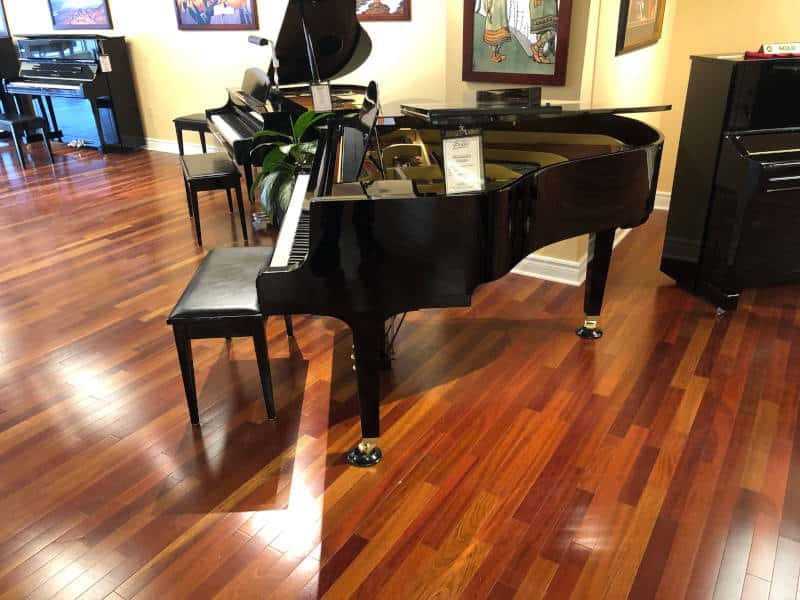 "Beautifully serviced 1987, 5'3"", model GH1 Yamaha Grand piano and matching bench in polished ebony finish including local delivery and 1 follow-up tuning approximately 3 months after delivery, $8,000.00 plus tax."